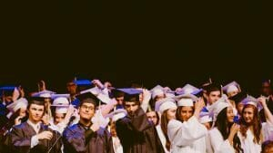 College Students Graduating with wearing hat